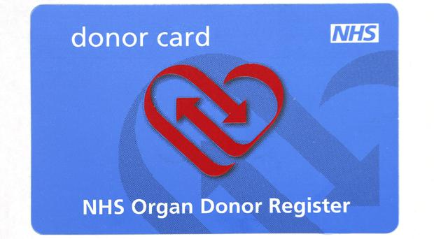 An NHS Organ Donor Register card (Philip Toscano/PA)