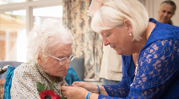 Rosemary Powell is presented with an MBE at her retirement home in west London by Vice Lord-Lieutenant of Greater London, Colonel Jane Davis (Stefan Rousseau/PA)