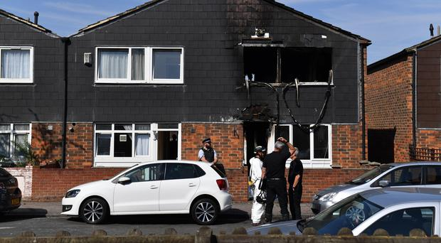 Police and forensics officers at the scene of the Deptford house fire (Dominic Lipinski/PA)