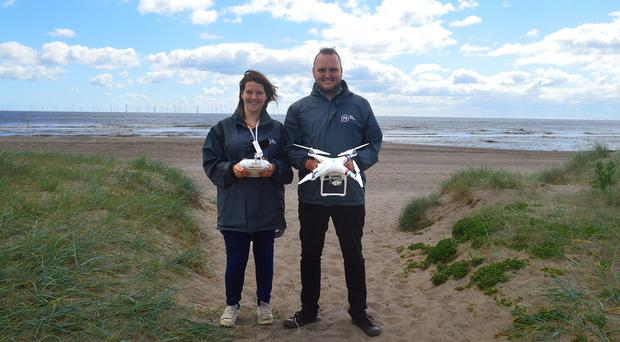 P3 outreach workers Lauren Gilbertson and Jamie Carr with a drone in the sand dunes at Skegness (P3)