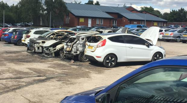 Burned out vehicles in the car park of HMP Birmingham Prison following reports of two masked men armed with a firearm (Richard Vernalls/PA)