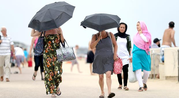 Thunderstorm warnings have been issued as the heatwave comes to an end (Andrew Matthews/PA)