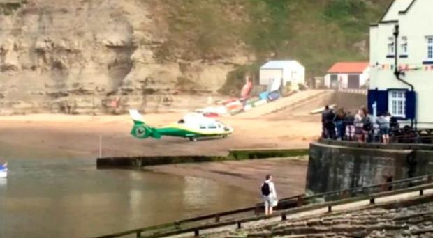 An air ambulance at the scene where a nine-year-old girl died