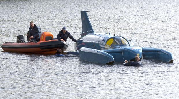 The restored Bluebird K7, which crashed killing Donald Campbell in 1967, takes to the water for the first time in more than 50 years off the Isle of Bute on the west coast of Scotland (David Cheskin/PA)