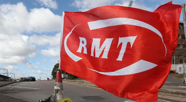 The RMT has announced three more strikes on Arriva Rail North in the long-running row over guards (Jonathan Brady/PA)