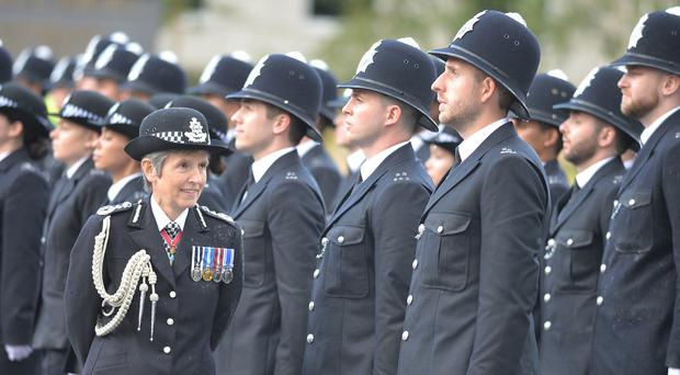Cressida Dick inspects new officers at a Passing Out parade (John Stilwell/PA)