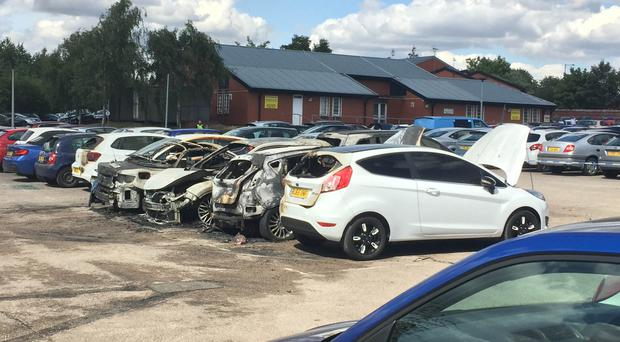 Burned-out vehicles outside HMP Birmingham, after an arson attack on the staff car park on Tuesday (Richard Vernalls/PA)