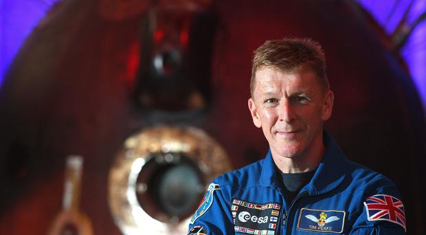 Major Tim Peake with the Soyuz descent module, the spacecraft which brought him back to Earth, at Peterborough Cathedral (Joe Giddens/PA)