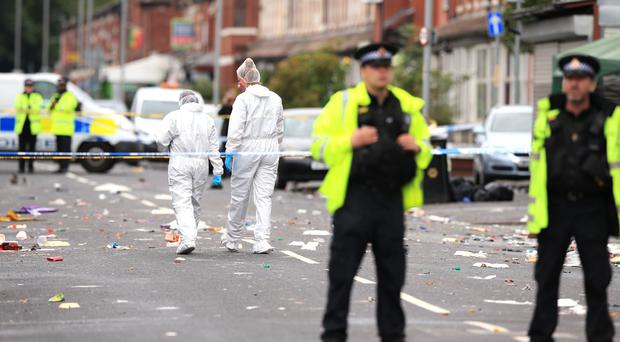 Police officers and forensics at the scene in Claremont Road, Moss Side (Peter Byrne/PA)