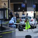 Forensic officers by the car that crashed into security barriers outside the Houses of Parliament (Stefan Rousseau/PA)