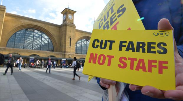 The RMT union is holding protests outside railway stations, including London's King's Cross, (PA)