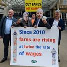 Rail, Maritime and Transport union (RMT) senior assistant general secretary Steve Hedley (left) and general secretary Mick Cash (right) join members dressed as Prime Minister Theresa May and Transport Secretary Chris Grayling taking part in a protest over train fares outside King's Cross station in London.