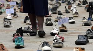 Shoes displayed outside Westminster Cathedral to highlight Pope Francis's refugee campaign (Stefan Rousseau/PA)