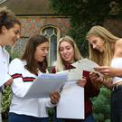 From left to right, Grace El-Mokadem, Maddie Backhouse, Claudia Ballard and Sophie Plumber read their A-level results at Brighton College in East Sussex (Gareth Fuller/PA)
