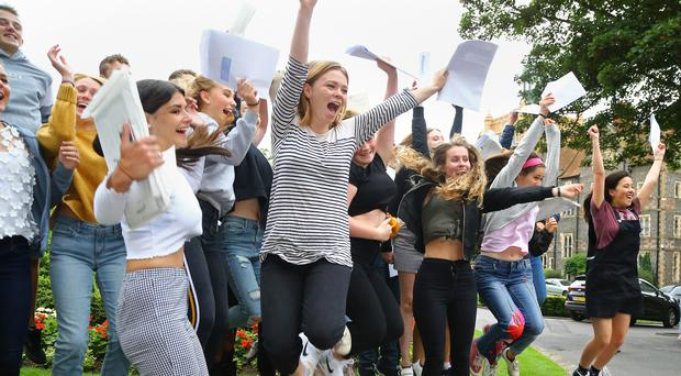 Students celebrate their A Level results at Brighton College in East Sussex (Gareth Fuller/PA)