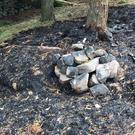 The remains of a camp fire which started a 200-acre moorland blaze near Leek (Staffordshire Fire and Rescue Service/PA)