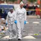Forensics officers in Claremont Road, where several people were injured in a shooting (Peter Byrne/PA)