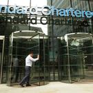 Standard Chartered has been waiting nearly nine months for EU officials to approve a banking licence (Yui Mok/PA)