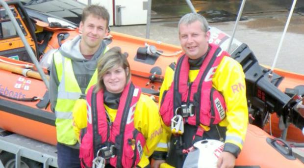 Karla Thresher with fellow D class helms Jake Sanderson (left) and Richard Huish (Chris Rundle/RNLI/PA)
