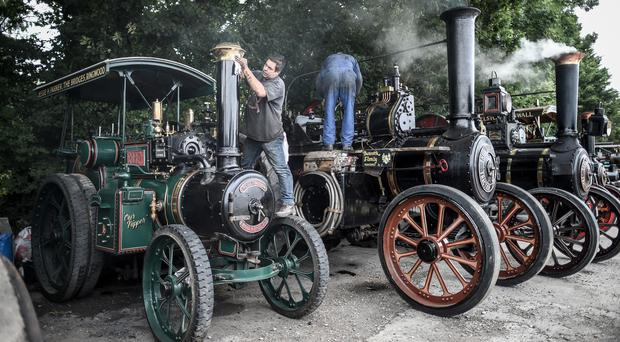 Steam enthusiasts clean their traction engines ahead of the Great Dorset Steam Fair (Ben Birchall/PA)