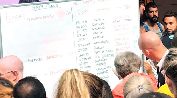 Passengers were forced to study whiteboards at Gatwick (Robin Blandford, D4H/PA)