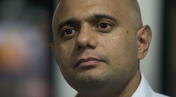 Home Secretary Sajid Javid has apologised to 18 members of the Windrush generation after a review found they may have been wrongfully removed or detained (Victoria Jones/PA)