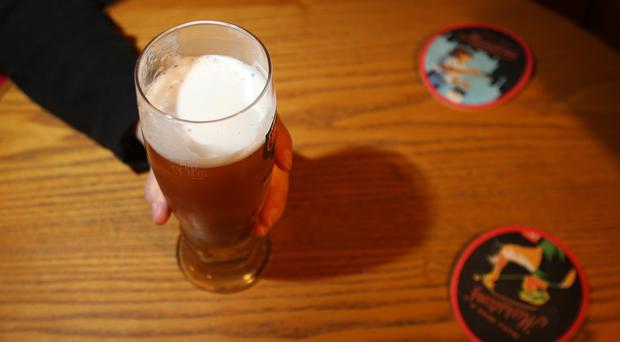 Moderate drinking has been linked to a lower risk of heart disease in a new study. (Lynne Cameron/PA)