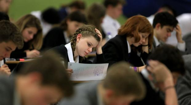 Traditional A* to G grades have been replaced with a 9 to 1 system (Gareth Fuller/PA)