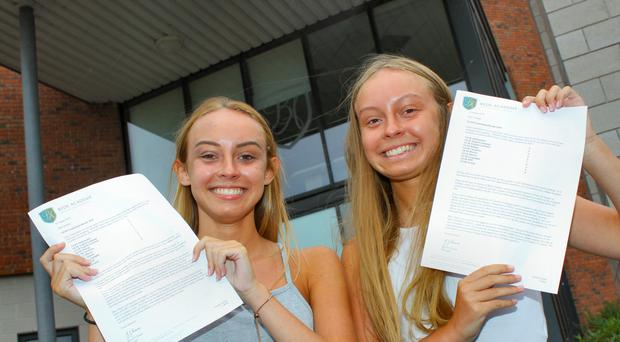 Scarlett (left) and Tabby Carling celebrate after scoring top grades (Bede Academy/PA)