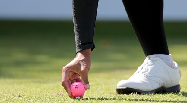 Thailand's Pornanong Phatlum places pink ball on tee during day four of the Ricoh Women's British Open at Royal Lytham and St Annes Golf Club. PRESS ASSOCIATION Photo. Picture date: Sunday August 5, 2018. See PA story GOLF Women. Photo credit should read: Richard Sellers/PA Wire. RESTRICTIONS: Editorial use only. No commercial use.