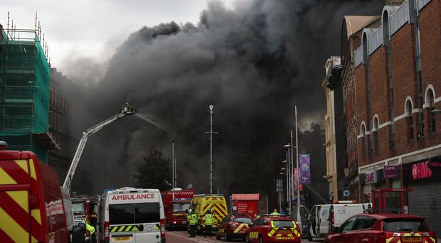 Fire and smoke from a major blaze which has broken out at the Primark store in Belfast city centre (Liam McBurney/PA)