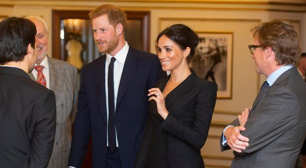 The Duke and Duchess of Sussex at the Victoria Palace Theatre in London, before attending a gala performance of the musical Hamilton
