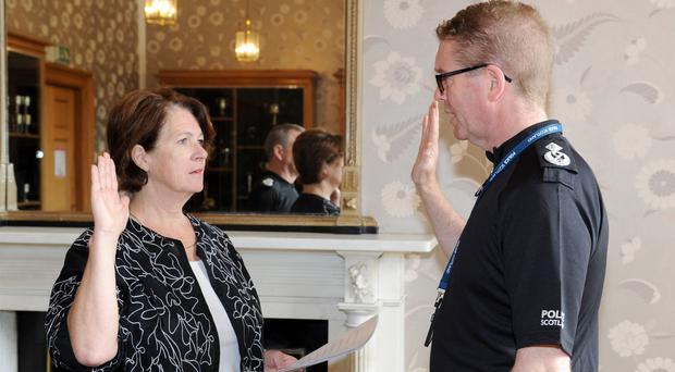 Deputy Chief Constable Will Kerr is sworn in by Justice of the Peace Gillian Thomson (Allan Bovill/PoliceScotland/PA)
