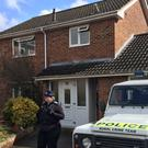 Police Support Officers standing outside the Salisbury home of Sergei Skripal