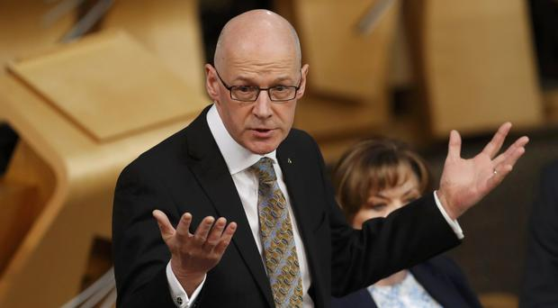 John Swinney has apologised for a 'misleading' letter on P1 testing (Russell Cheyne/PA)