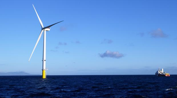 One of the 87 giant wind turbines of the Walney Extension wind farm, off the coast of Cumbria (Orsted/PA)