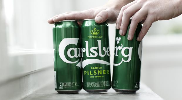 Dots of glue hold the cans in Carlsberg's new Snap Pack together (Carlsberg/PA)