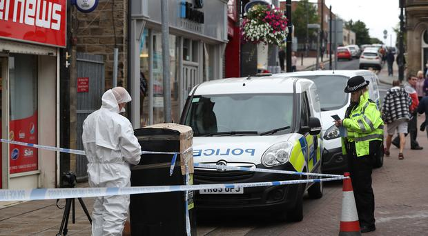 A forensic officer in Peel Square in Barnsley after the incident (Danny Lawson/PA)