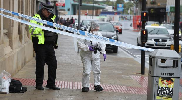 A police and a forensic officer in Barnsley town centre after the alleged stabbing (Danny Lawson/PA)