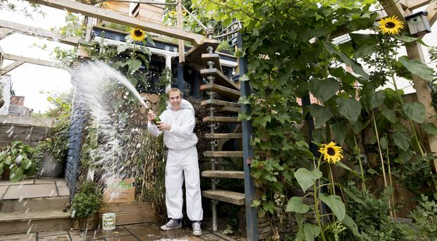 George Smallwood and his Bee Eco Shed (Cuprinol/PA)