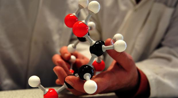 A scientist holds a molecular model in a classroom (Lauren Hurley/PA)