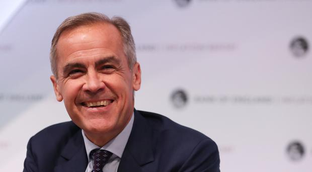 Bank of England Governor Mark Carney is to stay on until 2020 (PA)