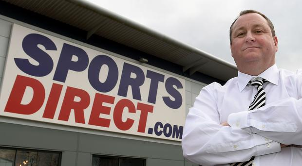 A judge says Mike Ashley's Sports Direct was justifiably criticised by lawyers representing a financial watchdog (Joe Giddens/PA)
