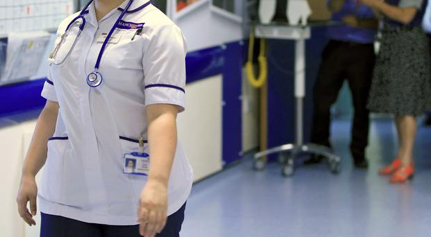 The legislation will mean NHS boards and care services are legally required to have appropriate numbers of trained staff in place (Peter Byrne/PA)