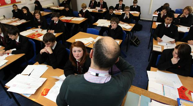 Teachers in Scotland have longer teaching hours than the international average (David Davies/PA)