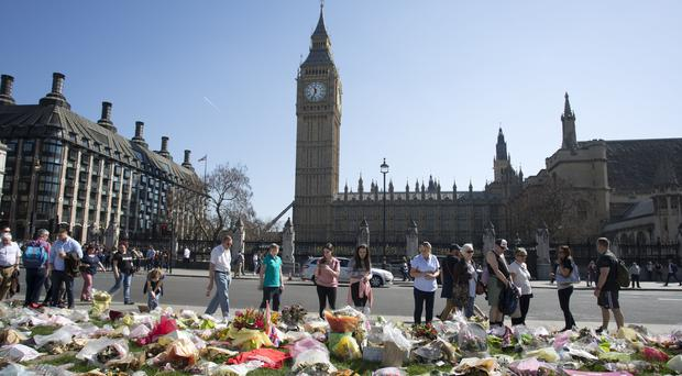 Floral tributes in Parliament Square outside the Palace of Westminster where the London terror attack took place (Isabel Infantes/PA)