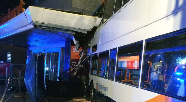 The double decker bus crashed into a Sainsbury's supermarket on Trinity Street in Coventry (WMAS/PA)
