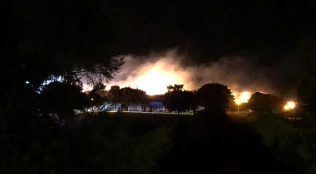 Firefighters worked through the night to tackle the blaze at Braeview Academy in Dundee (Graeme Mckenzie/Twitter/PA)