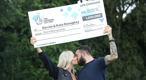Darren and Kate Donaghey from Newcastle, celebrate their £1 million National Lottery Scratchcard win (Owen Humphreys/PA)