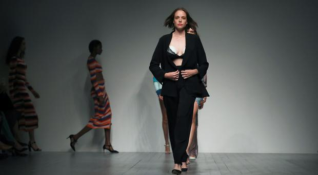 Valeria Garcia wears an innovative breast pump on the catwalk (Isabel Infantes/PA)